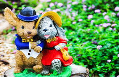 Mr and Mrs Rabbit Garden Ornament. With copy space royalty free stock photo
