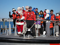 Mr and Mrs Santa Claus. The united States Coast Guard bring Mr and Mrs Santa Claus to Nantucket Island via boat royalty free stock image