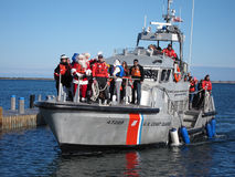 Mr and Mrs Santa Claus. The united States Coast Guard bring Mr and Mrs Santa Claus to Nantucket Island via boat stock image