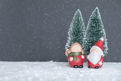 Mr. & Mrs. Santa Claus. In the forest to choose the tree stock photography