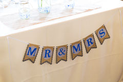 Mr and Mrs Sign at Wedding. Sign marking where the bride and groom are to sit on their wedding day says Mr and Mrs stock images