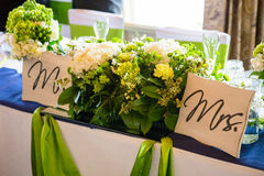 Mr and Mrs Table with Flowers Royalty Free Stock Photography