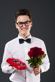 Mr Romantic. Man giving bouquet of roses and box of chocolates Royalty Free Stock Photography