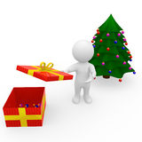 Mr. Smart Guy opens chrismas present Royalty Free Stock Images