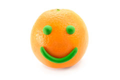 Mr. Smiley Orange. A cute smiley made of a real orange and a bit of modeling clay Royalty Free Stock Images