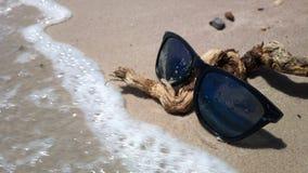 Mr. sun glasses on the beach. Mr. sun glasses on the sea beach stock photos