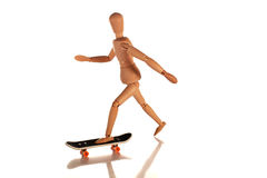 Mr.Wooden on skateboard Royalty Free Stock Image