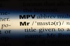 Mr. Word in a dictionary.  concept royalty free stock images