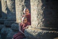 Mrauk U, MYANMAR - DEC 15, 2014: Young Novice monk and smile in. Mrauk U on December 15, 2014 in Mrauk U, Myanmar stock photo