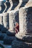 Mrauk U, MYANMAR - DEC 15, 2014: Young Novice monk and smile in. Mrauk U on December 15, 2014 in Mrauk U, Myanmar royalty free stock images