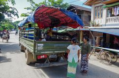 Women waiting at a pickup truck on the main road royalty free stock photography