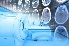 Free MRI Scanner Room With Images From A Computerized Tomography Of The Brain Royalty Free Stock Image - 115189976