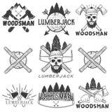 Märker förser med märke fastställda skogsarbetarelogoer för vektorn, emblem, baner, eller Monokrom isolerad illustration med skog Arkivfoto