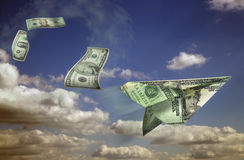 Mrketing Money. Dollar bills and clouds  suspended in blue skies Royalty Free Stock Image