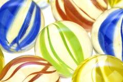 Mármores de vidro coloridos, fim acima Fotografia de Stock Royalty Free