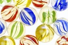 Mármores de vidro coloridos, fim acima Imagens de Stock Royalty Free
