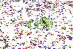 Mármores do brinquedo no fundo branco Imagens de Stock Royalty Free