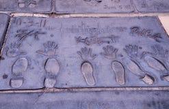 Mroczne gwiazdy filmowa ręki i stopa druki Zdjęcia Royalty Free