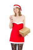 Mrs. Claus with bell and golden gift Royalty Free Stock Photos