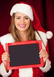 Mrs Claus with a blackboard Royalty Free Stock Photos