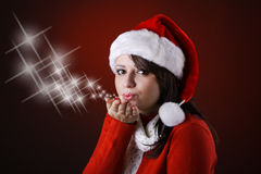 Mrs. Claus blowing kisses Royalty Free Stock Photography