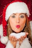 Mrs Claus blowing snow Stock Photography