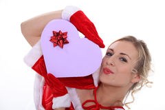 Mrs Claus. With a box of chocolates stock photography