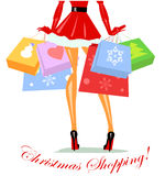 Mrs Claus carrying shopping bags Stock Image