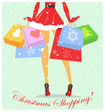 Mrs Claus carrying shopping bags Stock Photography