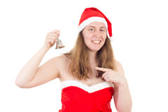 Mrs. Claus chiming christmas bell. Young Mrs. Claus chiming the christmas bell Royalty Free Stock Photo
