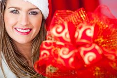 Mrs Claus with Christmas present Stock Image