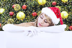 Mrs Claus with copyspace over christmas tree Stock Photo