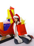 Mrs. Claus Holding shopping bags and gifts Stock Photos