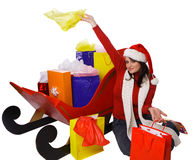 Mrs. Claus Holding shopping bags next to Royalty Free Stock Photography