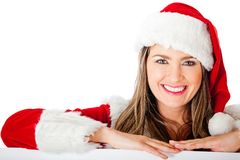 Mrs Claus leaning on a banner Stock Photo