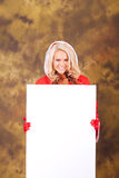 Mrs. Claus List. Mrs. Claus holding a blank sign for advertising Royalty Free Stock Photo