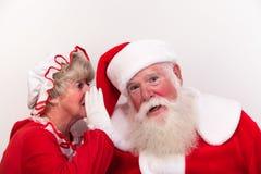 Mrs Claus mówi sekret obraz royalty free