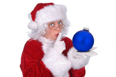 Mrs. Claus with ornament. Mrs. Claus with a Christmas ball in her hand isolated over white royalty free stock photo