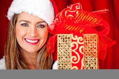 Mrs. Claus with a present Stock Images