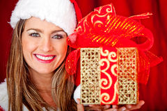 Mrs. Claus with a present Stock Image