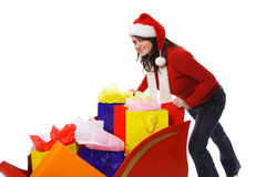 Mrs. Claus pushing sleigh full of shopping bags Royalty Free Stock Photos