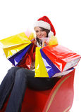 Mrs. Claus with shopping bags Stock Photos
