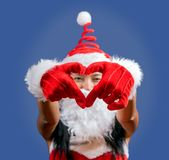 Mrs. Claus shows the gesture of heart. Cheerful Mrs Claus makes a symbol of love royalty free stock photo