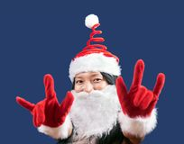 Mrs. Claus shows the gesture of the horns. Cheerful Mrs Claus makes a gesture symbol of the demons stock images