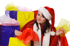 Mrs. Claus sitting next to Santas Sleigh holding h Royalty Free Stock Images