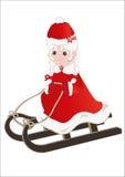 Mrs. Claus on snow sledding Stock Photos