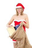 Mrs. Claus taking gifts out of her jute bag Royalty Free Stock Photos
