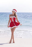 Mrs. Claus on tropical beach Royalty Free Stock Images