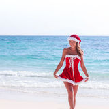 Mrs. Claus on tropical beach Royalty Free Stock Image