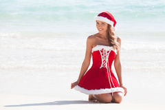 Mrs. Claus on tropical beach. Beautiful woman in Mrs. Claus custume on tropical beach, Christmas vacations concept royalty free stock images